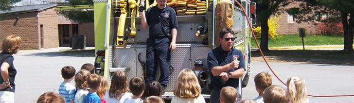 Firefighter Talking to Kids